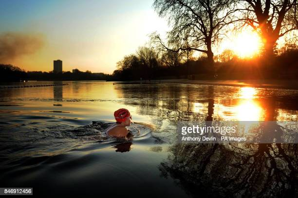 Angela Lurssen braves the early morning cold weather to swim in the Serpentine in Hyde Park London as parts of Britain were placed on amber alert...