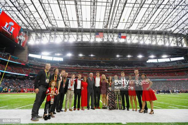 Angela Macuga and Atlanta Falcons owner Arthur Blank pose with family prior to Super Bowl 51 against the New England Patriots at NRG Stadium on...
