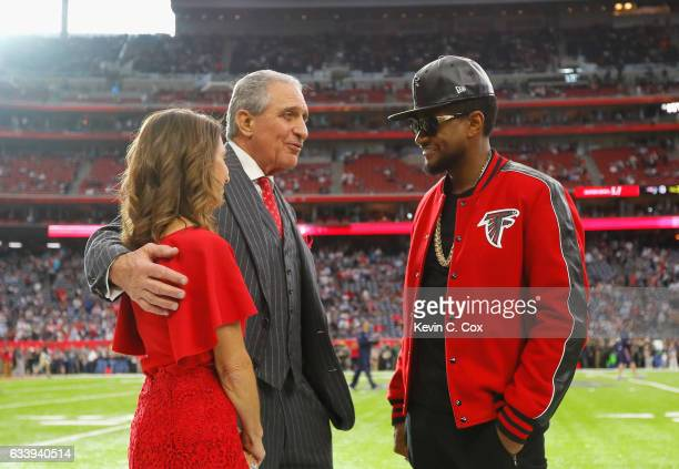 Angela Macuga Atlanta Falcons owner Arthur Blank and Usher speak prior to Super Bowl 51 against the New England Patriots at NRG Stadium on February 5...