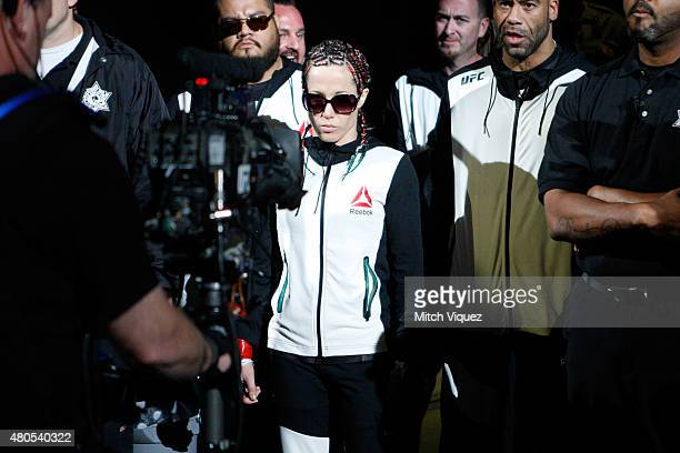 Angela Magana enters the arena for her fight against Michelle Waterson in their women's strawweight bout during the Ultimate Fighter Finale inside...