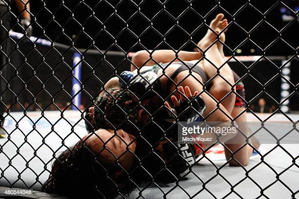 Angela Magana grapples with Michelle Waterson in their women's strawweight bout during the Ultimate Fighter Finale inside MGM Grand Garden Arena on...