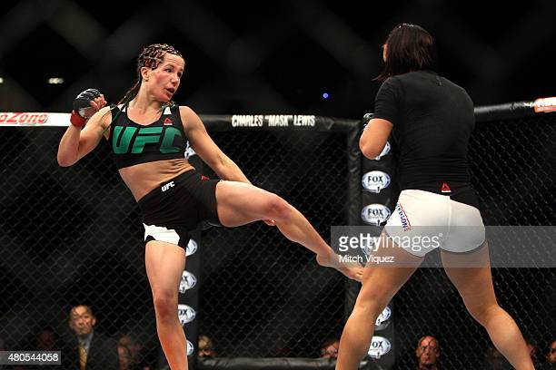 Angela Magana kicks Michelle Waterson in their women's strawweight bout during the Ultimate Fighter Finale inside MGM Grand Garden Arena on July 12...