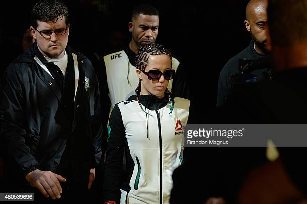 Angela Magana walks to the Octagon to face Michelle Waterson in their women's strawweight bout during the Ultimate Fighter Finale inside MGM Grand...