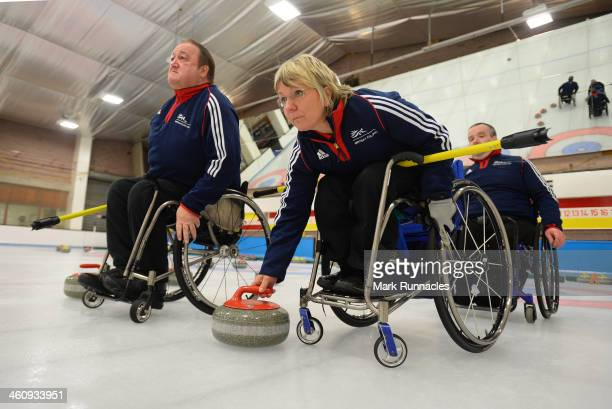 Angela Malone watched by Tom Killin in action during the ParalympicsGB Wheelchair Curling Training Day on 6th January 2014 in Hamilton Scotland