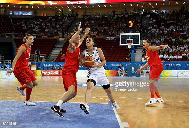 Angela Marino of New Zealand drives against Laia Palau of Spain during their women's basketball game on Day 3 of the Beijing 2008 Olympic Games at...