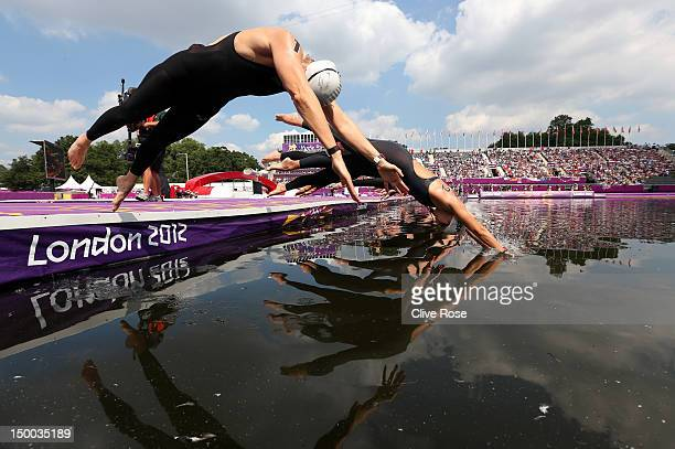 Angela Maurer of Germany and Erika Villaecija Garcia of Spain dive into the water to start the Women's Marathon 10km Swimming at Hyde Park on August...