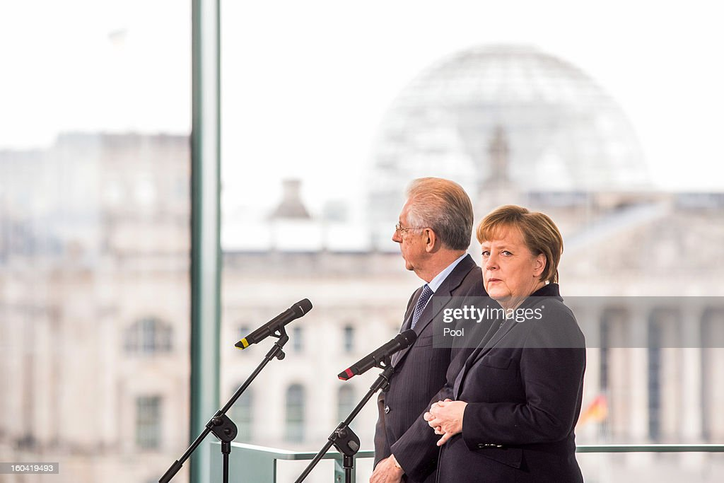 Angela Merkel and visiting Italian Prime Minister Mario Monti attend a press conference before their meeting at the Chancellery on January 31, 2013 in Berlin, Germany. The German Chancellor is meeting with Italian Prime Minister Mario Monti and Spanish Prime Minister Mariano Rajoy in Berlin to hold EU budget talks in preparation for the EU Summit to be held in Brussels next week.