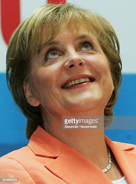 Angela Merkel, chairwoman of Germany's Christian Democrats is introduced as the opposition's candidate to challenge Chancellor Schroeder in the...