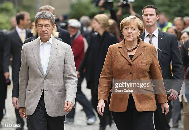 Angela Merkel German Chancellor and Chairwoman of the German Christian Democrats and her husband Joachim Sauer depart after casting their ballots in...