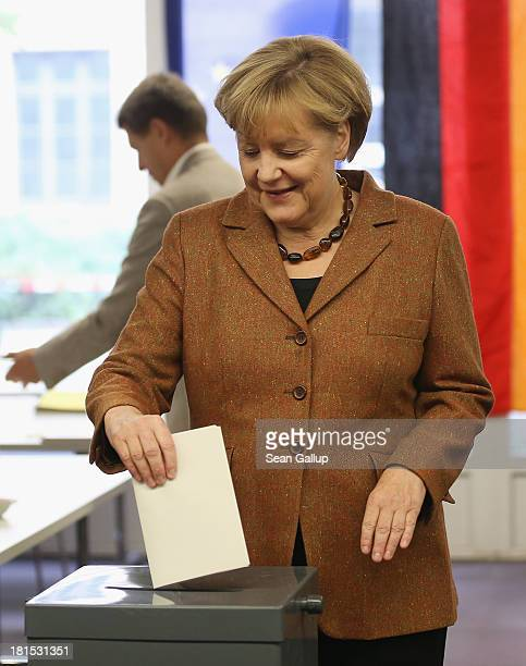 Angela Merkel German Chancellor and Chairwoman of the German Christian Democrats casts her ballot with her husband Joachim Sauer in German federal...