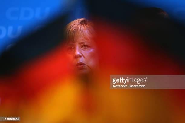Angela Merkel, German Chancellor and Chairwoman of the German Christian Democrats , celebrates with supporters at CDU headquarters...