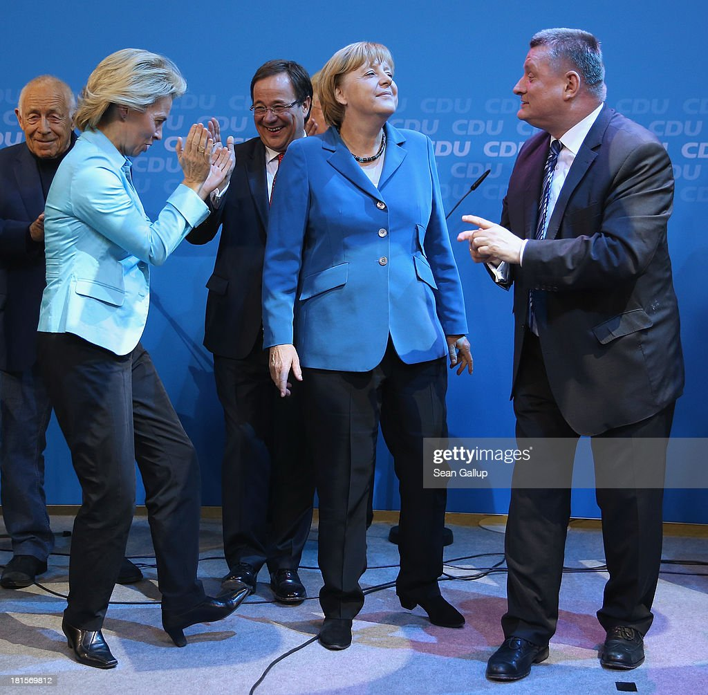 Angela Merkel (C), German Chancellor and Chairwoman of the German Christian Democrats (CDU), celebrates with leading members of her party, including Minister of Work and Social Issues Ursula von der Leyen (L) and CDU General Secretary Hermann Groehe, at CDU headquarters after initial results give the CDU 42% of the vote in German federal elections on September 22, 2013 in Berlin, Germany. Germany is holding federal elections that will determine whether Merkel will remain chancellor for a third term. Though the CDU has a strong lead over the opposition, its partner party in the current government coalition, the German Free Democrats (FDP), failed to gain the 5% necessary to retain seats in the Bundestag and speculations run wide as to what coalition will be viable in coming weeks to create a new government.