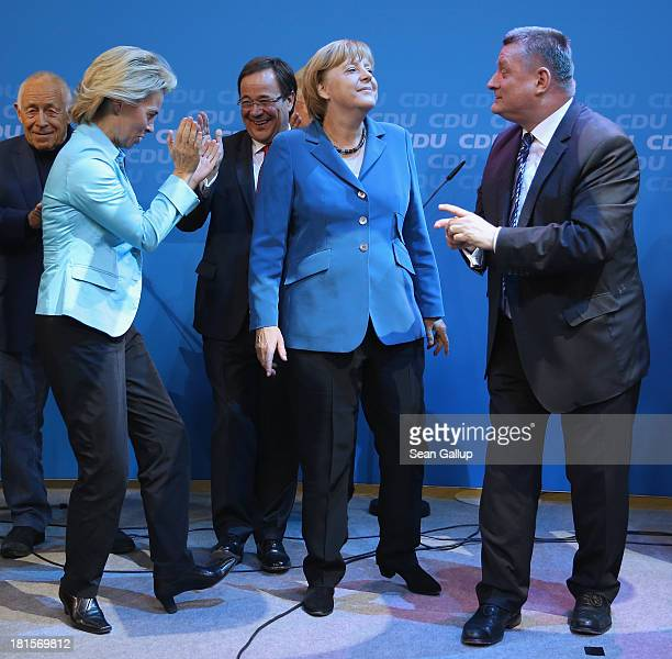 Angela Merkel German Chancellor and Chairwoman of the German Christian Democrats celebrates with leading members of her party including Minister of...