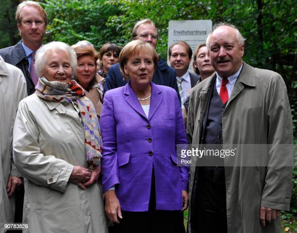 Angela Merkel German Chancellor and leader of the conservative Christian Democratic Union party CDU is flanked by Konrad Adenauer grandson of...