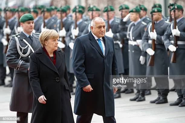 Angela Merkel German chancellor welcomes Boyko Borisov Prime Minister of Bulgaria with military honors at the German chancellery on December 15 2014...