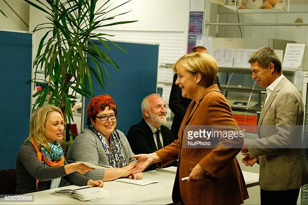 Angela Merkel German Chancellor with her husband cast her ballot for the 18th German parliamentary election on Studentenwerk Mensa in Berlin on Sept...