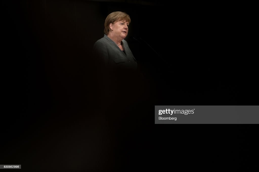 Angela Merkel, Germany's chancellor and Christian Democratic Union (CDU), speaks during a campaign event in Dortmund, Germany, on Saturday, Aug. 12, 2017. Merkelopened her re-election campaign with criticism of the nations auto executives, saying they need to embrace new technology more quickly to protect jobs and repair damage done by adiesel cheating scandal. Photographer: Jasper Juinen/Bloomberg via Getty Images