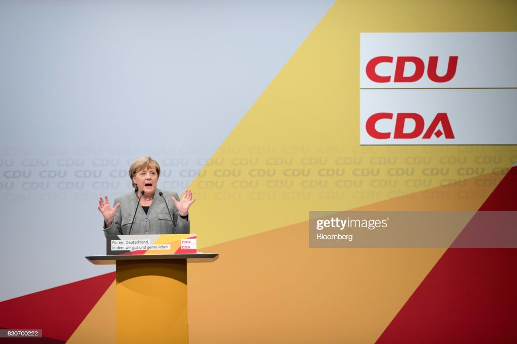 Angela Merkel, Germany's chancellor and Christian Democratic Union (CDU) leader, gestures as she speaks during a campaign event in Dortmund, Germany, on Saturday, Aug. 12, 2017. Merkelopened her re-election campaign with criticism of the nations auto executives, saying they need to embrace new technology more quickly to protect jobs and repair damage done by adiesel cheating scandal. Photographer: Jasper Juinen/Bloomberg via Getty Images