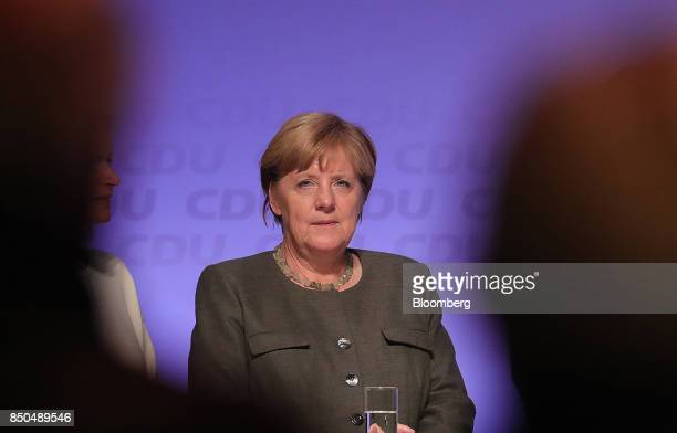Angela Merkel Germany's chancellor and Christian Democratic Union leader looks on during an election campaign rally in Hamburg Germany on Wednesday...