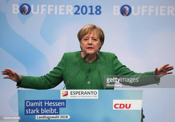Angela Merkel Germany's Chancellor and Christian Democratic Union party leader gestures while speaking during a campaign rally ahead of Hesse state...