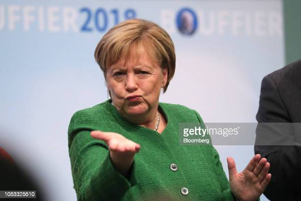 Angela Merkel Germany's Chancellor and Christian Democratic Union party leader gestures during a campaign rally ahead of Hesse state election in...