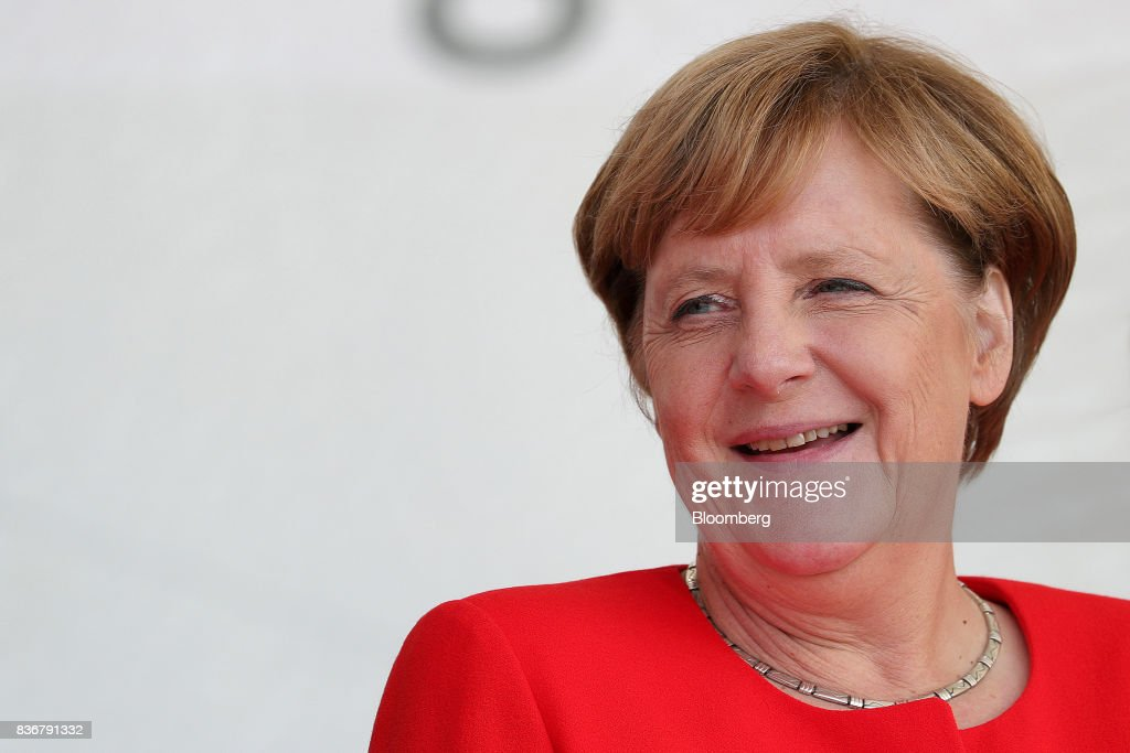 Angela Merkel, Germany's chancellor and Christian Democratic Union (CDU) leader, reacts during an election campaign stop in Saint Peter-Ording, Germany, on Monday, Aug. 21, 2017. Merkel headed out on the campaign trail last week and quickly faced disruption by anti-immigration demonstrators, a reminder that the refugee crisis that sent her popularity plunging in 2016 remains a residual risk. Photographer: Krisztian Bocsi/Bloomberg via Getty Images