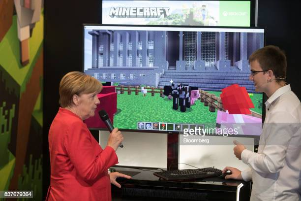 Angela Merkel Germany's chancellor and Christian Democratic Union leader visits the Minecraft exhibition stand at Gamescom video games trade fair in...