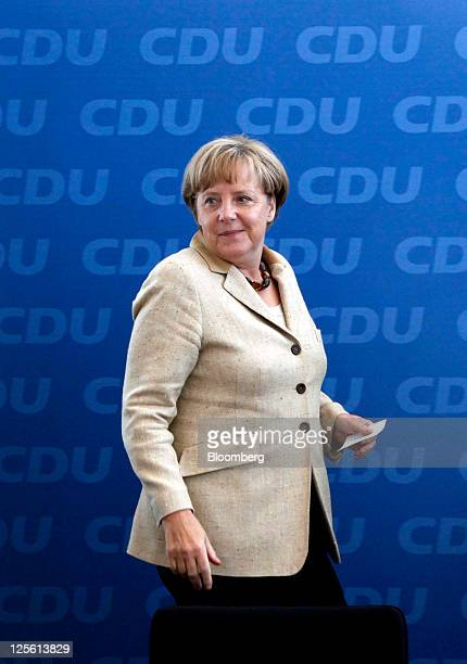 Angela Merkel Germany's chancellor and leader of the Christian Democratic Union party arrives to speak to members of the CDU party at their...