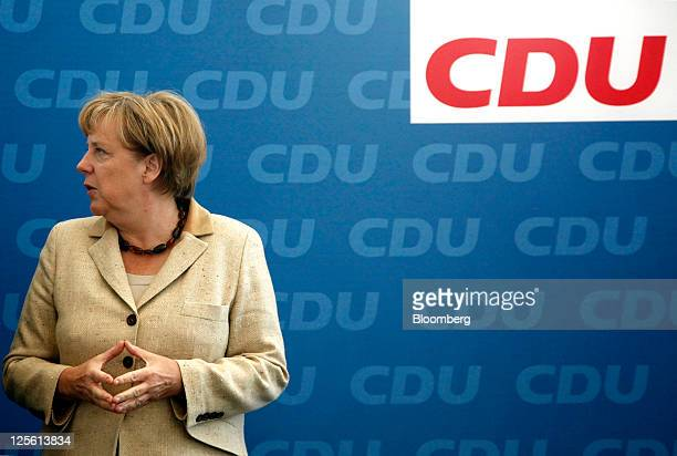 Angela Merkel Germany's chancellor and leader of the Christian Democratic Union party pauses before speaking to members of the CDU party at their...