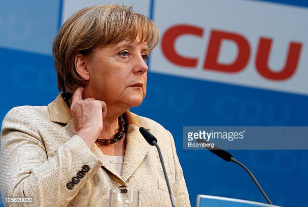 Angela Merkel Germany's chancellor and leader of the Christian Democratic Union party pauses during a news conference at the CDU party headquarters...