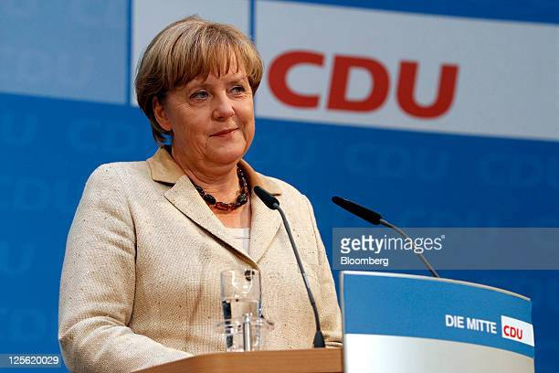 Angela Merkel Germany's chancellor and leader of the Christian Democratic Union party reacts during a news conference at the CDU party headquarters...