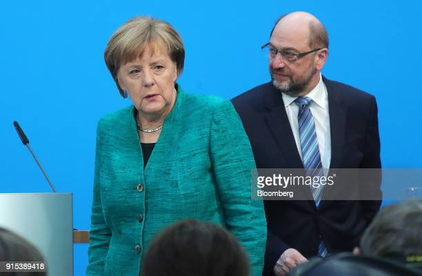 Angela Merkel Germany's chancellor and leader of the Christian Democratic Union party left and Martin Schulz leader of the Social Democrat Party exit...