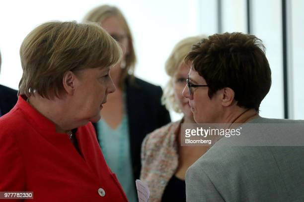 Angela Merkel Germany's chancellor and leader of the Christian Democratic Union party left speaks with Annegret KrampKarrenbauer general secretary of...