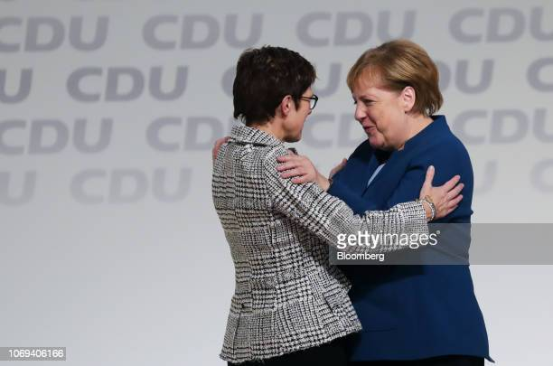 Angela Merkel Germany's chancellor and outgoing Christian Democrat Union leader right congratulates Annegret KrampKarrenbauer general secretary of...