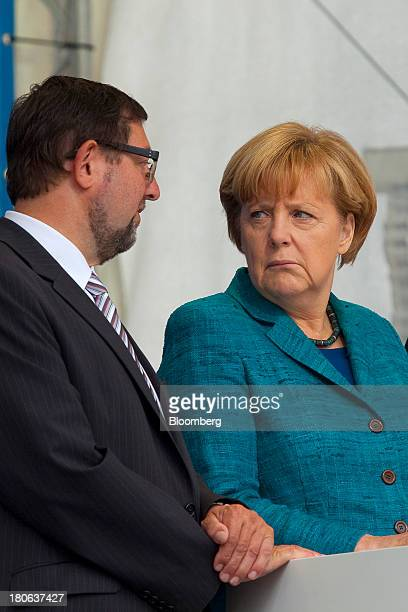 Angela Merkel Germany's chancellor and party leader of the Christian Democratic Union listens to CDU member Andreas Lämmel before she speaks during...