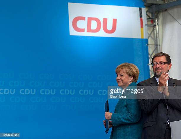 Angela Merkel Germany's chancellor and party leader of the Christian Democratic Union stands next to CDU member Andreas Lämmel right before she...