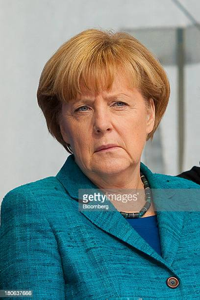 Angela Merkel Germany's chancellor and party leader of the Christian Democratic Union awaits her turn to speak during an election rally in Dresden...