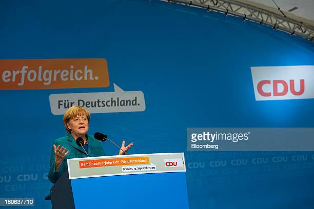 Angela Merkel Germany's chancellor and party leader of the Christian Democratic Union speaks during an election rally in Dresden Germany on Sunday...