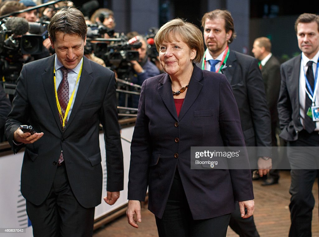 Angela Merkel, Germany's chancellor, arrives for a European Union (EU) summit meeting in Brussels, Belgium, on Thursday, Dec. 18, 2014. The EU outlawed the sale of some energy-exploration equipment to Crimea, seeking to prevent Russia from using the newly annexed Ukrainian peninsula to exploit Black Sea oil and gas deposits. Photographer: Jasper Juinen/Bloomberg via Getty Images