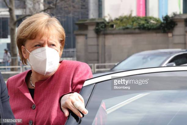 Angela Merkel, Germany's chancellor, arrives for ahead of a news conference following a caucus meeting of Germany's ruling coalition in Berlin,...