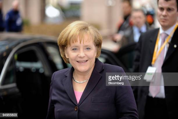Angela Merkel Germany's chancellor arrives for the European Union emergency summit at EU headquarters in Brussels Belgium on Sunday March 1 2009...