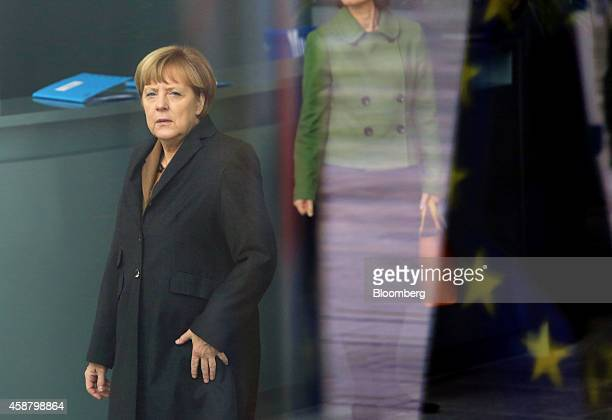 Angela Merkel Germany's chancellor awaits the arrival of Nawaz Sharif Pakistan's prime minister at the Chancellery in Berlin Germany on Tuesday Nov...