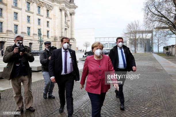 Angela Merkel, Germany's chancellor, center, arrives for ahead of a news conference following a caucus meeting of Germany's ruling coalition in...