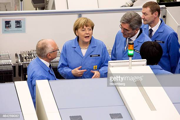 Angela Merkel Germany's chancellor center Joe Kaeser chief executive officer of Siemens AG third right and KarlHeinz Buettner head of Siemens AG...