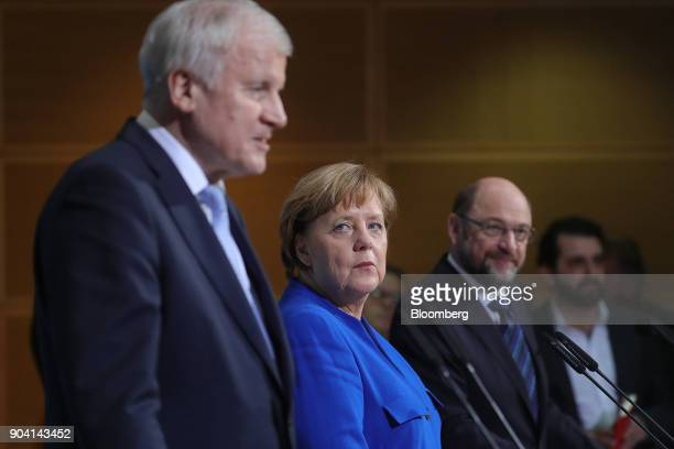 Angela Merkel Germany's chancellor center looks towards Horst Seehofer leader of the Christian Social Union party during a news conference following...