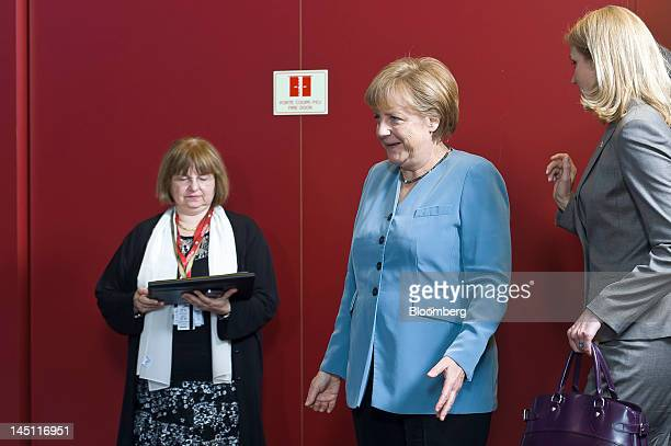 Angela Merkel Germany's chancellor center reacts as she arrives for the family photograph with Helle ThorningSchmidt Denmark's prime minister right...