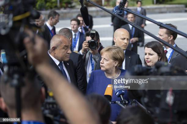 Angela Merkel Germany's chancellor center reacts as she stands beside Boyko Borissov Bulgaria's prime minister while making a statement to...