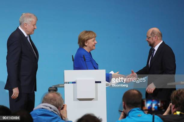 Angela Merkel Germany's chancellor center shakes hands with Martin Schulz leader of the Social Democrat Party right as Horst Seehofer leader of the...