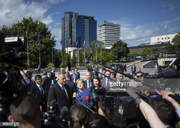 Angela Merkel Germany's chancellor center speaks to journalists as she stands beside Boyko Borissov Bulgaria's prime minister center left ahead of a...