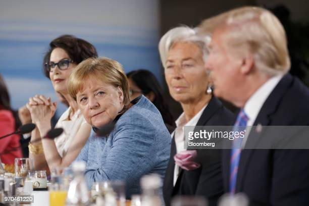 Angela Merkel Germany's chancellor center watches as US President Donald Trump right arrives for the Group of Seven Gender Equality Advisory Council...